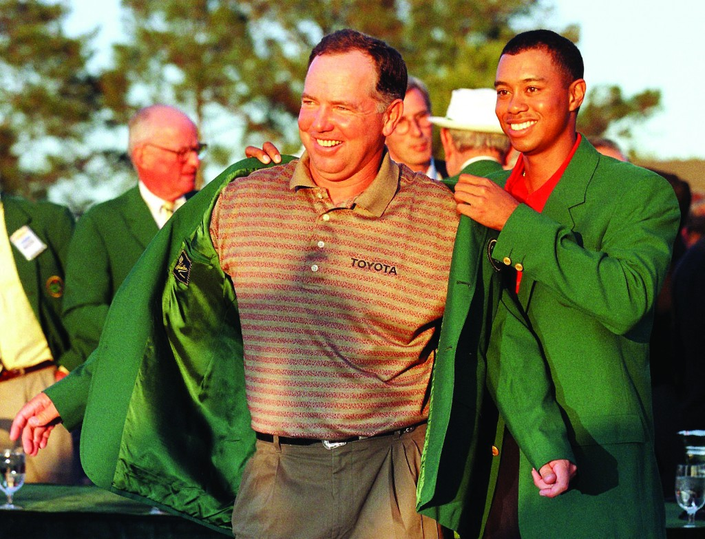 Mark O'Meara (L) gets the Green Jacket from Tiger