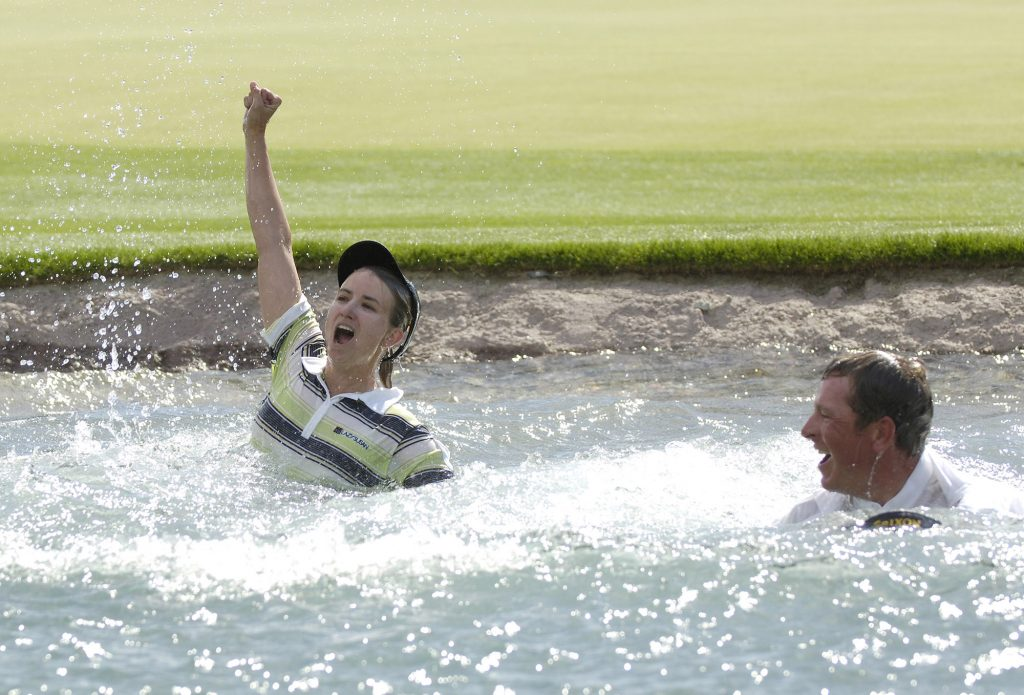 Karrie Webb, winner of the Kraft Nabisco Championship, takes the traditional dip into Poppy's Pond at The Mission Hills Country Club in Rancho Mirage, California on Sunday, April 2, 2006. (Photo by S. Levin/Getty Images)