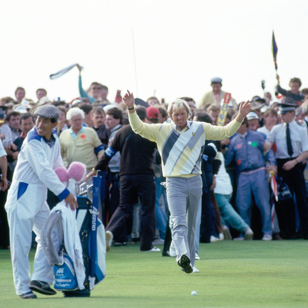 Greg Norman of Australia (centre) acknowledges the crowd on the 18th fairway during the final round of the British Open Golf Championship held at the Turnberry Golf Resort, Scotland, 20th July 1986. Greg Norman won the Championship by 5 strokes. (Photo by Phil Sheldon/Popperfoto/Getty Images)